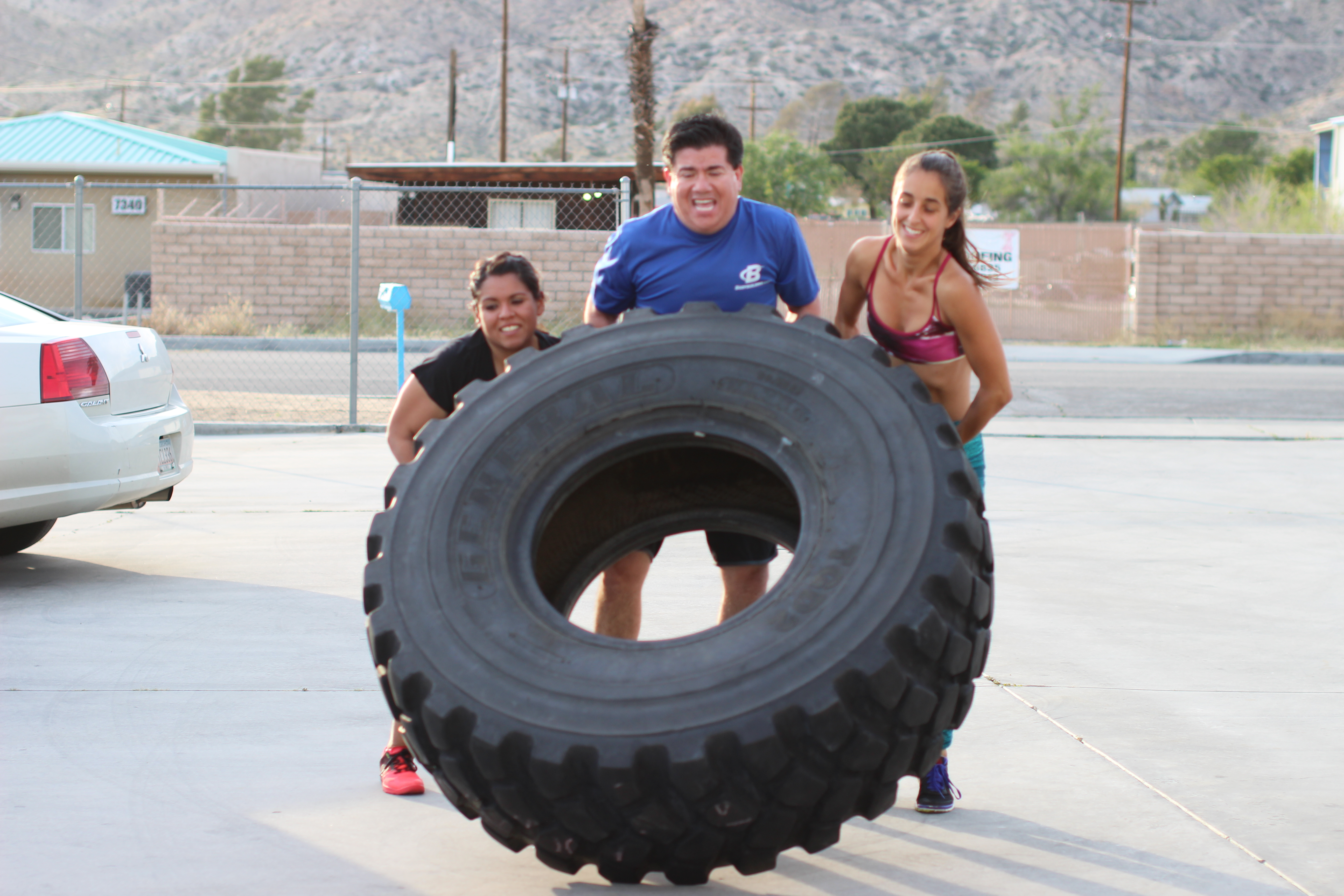 Amy, Jesse, and Claudia handling the tire flips!